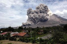 In this April 1, 2015 photo, Mount Sinabung releases pyroclastic flows seen from Tiga Serangkai, North Sumatra, Indonesia. Mount Sinabung, among about 130 active volcanoes in Indonesia, has sporadically erupted since 2010 after being dormant for more then 400 years. (AP Photo/Binsar Bakkara, File)