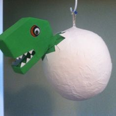 Dinosaur Piñata:  paper mâché over a large-punch-balloon and made the Dino head out of a cracker box and a small juice bottle