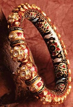 Heavy bangle kada with studded stones and colored work