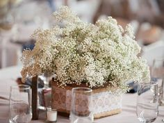 Baby's breath is adorable, affordable and impactful. Gather bunches in rustic containers like this burlap-and-lace covered one for simple, chic rustic wedding reception centerpieces. Vintage Wedding Centerpieces, Rustic Wedding Centerpieces, Diy Centerpieces, Wedding Decorations, Inexpensive Centerpieces, Table Decorations, Chic Wedding, Trendy Wedding, Wedding Table