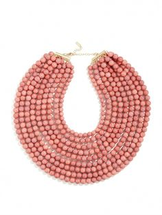 f1894945ad5e Coral beaded strands that hang at different lengths. Beautiful necklace to  dress up a plain work top.