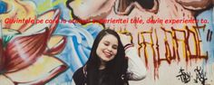woman wearing black and white letterman jacket standing in front of mural painting Girl - Infinity Collections