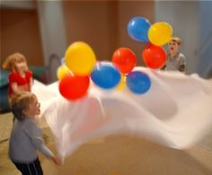Bed Sheet Parachute - Bounce balloons, small/lightweight balls, or even rolled up socks on a bed sheet for simulating fun parachute games! Balloon Games For Kids, Indoor Activities For Kids, Summer Activities, Parachute Games For Kids, Preschool Games, Montessori Activities, Physical Activities, Family Activities, Outdoor Activities