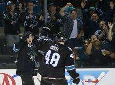 San Jose Sharks forwards Tommy Wingels and Tomas Hertl fist bump after Wingels scored an empty net goal (March 12, 2015).