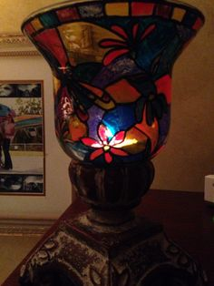 A candle holder I transformed into faux stained glass