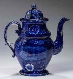 """Northeast Auctions - THE COLLECTION OF CHESTER CREUTZBURG AND DAVID MARTIN - PART ONE. 3/5/16.  Lot 124: COMMODORE MACDONNOUGH'S VICTORY: FLORAL BORDER-IRREGULAR CENTER,' RARE STAFFORDSHIRE DARK BLUE TRANSFER-PRINTED COFFEEPOT AND COVER, ENOCH WOOD & SONS, BURSLEM, 1819-46.  Estimated Price: $1,500 - $2,500. Realized: $1,080 (900).  Description: Each view printed """"MAC DONNOUGH'S VICTORY,"""" impressed letter """"S,"""" numeral or letter in underglaze-blue. Height 10 3/4 inches. Provenance: Weston H…"""