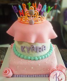 Tiara custom cake ~strawberry cake + whipped white chocolate filling + fondant-covered/pearl border/roses + gumpaste tiara By: icing on the k| karen custom cakes|