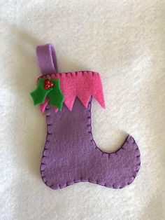 A personal favorite from my Etsy shop https://www.etsy.com/listing/576988119/stocking-felt-ornament-purple-and-pink