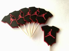 Jumpman Onesie Inspired Cupcake Toppers These adorable cupcake toppers are the perfect addition for your next party or event. They can be used on cupcakes or as food picks on appetizers. You will receive 12 toppers. Onesie measures approx 1.5 inches tall and is attached to a food Baby Shower Parties, Baby Shower Themes, Baby Shower Decorations, Shower Ideas, Jordan Baby Shower, Baby Boy Shower, Michael Jordan Birthday, Basketball Birthday, Basketball Party