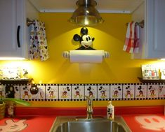 the LOVE of Disney! My kitchen. Love the colander light. Want to do that!