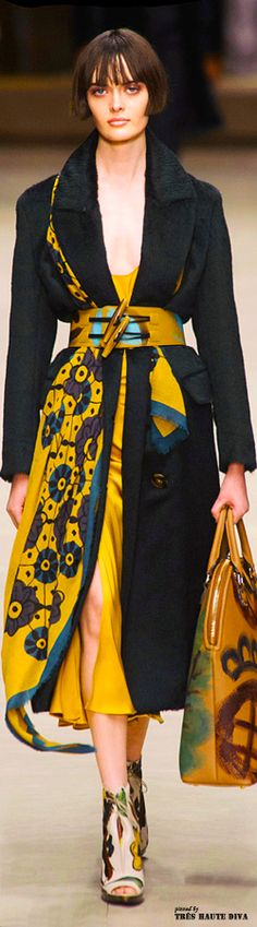 Pinner's note: this coat is not asymmetric -- it's the scarf, a long rectangle, held in asymmetric placement by the belt, that gives it the look