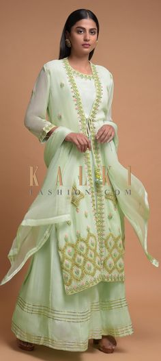 Buy Online from the link below. We ship worldwide (Free Shipping over US$100)  Click Anywhere to Tag Pista Green Skirt And Crop Top In Cotton With Long Floral Embroidered Jacket Online - Kalki Fashion Pista green skirt and crop top in cotton with zardozi and thread embroidered neckline.Crafted sleeveless with round neckline.