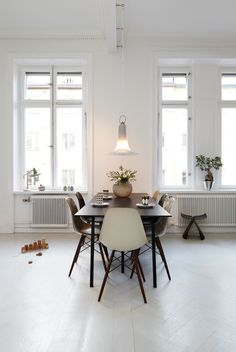 Scandinavian design. Eames style Chairs. Monochromatic color scheme. Herringbone floors.