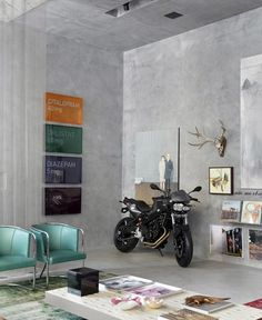 mint chairs, cement walls & who says you can't decorate aroom with a real motorcycle? :)