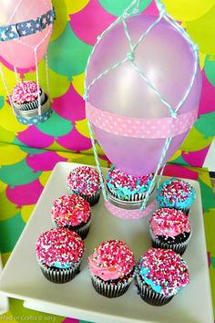 Hot Air Balloon Treat Table •Balloons, favor tins, washi tape, baker's twine, scissors, double-sided tape •Tutorial