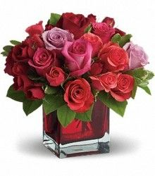 Madly In Love: With a name that says it all, express your love and affection with this beautiful, 18 short stem rose arrangement in a ruby-red glass cube.