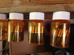 Winner: Hang Your Batteries for Easy Storage - and other ideas for old pill bottles: