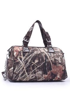 "RealTree® Waterfowl Camo Stud Brown Handbag | Trendy Country Girl® handbag featuring licensed Max-4 Waterfowl Realtree® camo canvas and brown faux leather accents. The handbag has zipper closure, 2 inside zipper pockets, and 2 pouch pockets. The bag measures 13"" L x 10"" H x 5"" W."