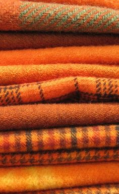 Orange hue wool flannel blankets for autumn - for the front porch!