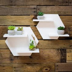 These hexagon shaped shelves are a delightful addition to your wall and perfect for displaying your plant collection or any knick knacks of your choosing. The clean white shelf set makes a versatile d