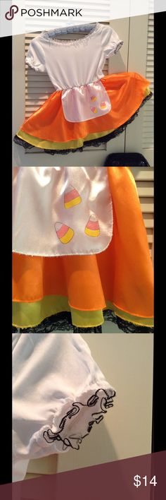 """Sweet Candy Corn Halloween Costume ADORABLE!    Candy Princess Dress is bright and adorable. Waist to waist is 12"""" and has elastic stretch. The pumpkin orange skirt sports a sunny yellow lining with black lace. Waist to hemline is 13"""". Candy corn decor, neck and cuff trim has black nylon accent. Polyester cotton and nylon. Comes from a smoke free home. Trick or Treat. Children's Place Costumes Halloween"""