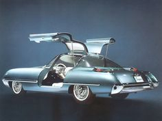 The Ford Cougar concept car was unveiled at the 1962 Chicago Auto show— five years before Mercury's Cougar. The Ford Cougar was powered by a 406-cid V8 and had electrically operated gullwing doors. The Cougar appeared in the 1963 Jack Lemon movie Under the Yum Yum Tree.