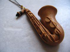 A polymer clay saxophone, matchstick size