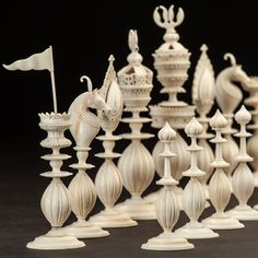 India, First half of the 19th century A complete and rare Indian Berhampur carved ivory and stained ivory chess set – the one side of natural ivory and the other side stained black - a very fine example of early 19th century carved flame design.