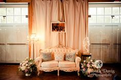 Lounges and sofas at reception, customized pillows and gorgeous vases filled with pink and white roses, standing floor chandelier   Andrew & Kathy's wedding in Tallahassee, Florida at Wildwood Church and Goodwood Museum & Gardens   Elizabeth Davis Photography Florida Weddings. Click here to see the whole lovely wedding and all the details: http://elizabethdavisphotoblog.com/andrew-kathys-wedding-photography-august-31-2013-florida/