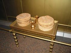 The Table of Showbread was a small table made of acacia wood and overlaid with pure gold. It measured 3  by 1.5 feet and was 2 feet, 3 inches high. It stood on the right side of the Holy Place across from the lampstand and held 12 loaves of bread, representing the 12 tribes of Israel.  The priests baked the bread with fine flour and it remained on the table before the Lord for a week; every Sabbath day the priests would remove it and eat it in the Holy Place, then put fresh bread on the…