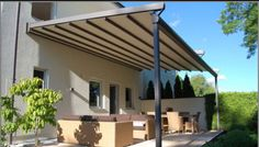 The remote control retractable Veranda Call 07904791190 Alfresco design ltd