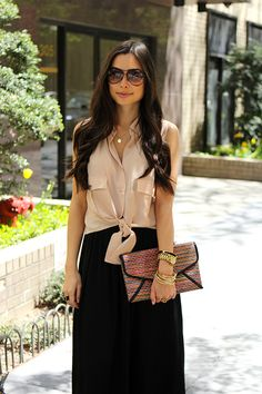 Neutral blouse, black maxi skirt, clutch and gold jewelry