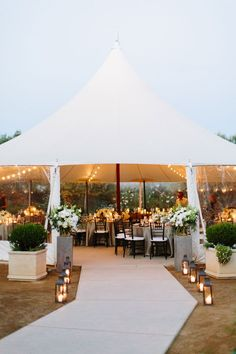minimalist tent wedding with wooden accents and floral