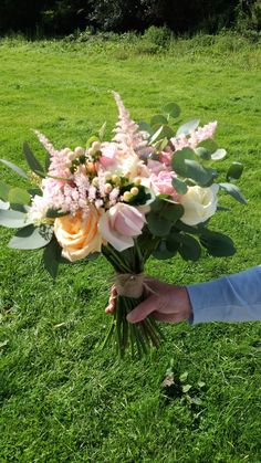 Soft pastels of pinks ivory and peach make the perfect summer bouquet....