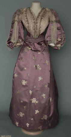 "TRAINED PURPLE BROCADE EVENING GOWN, c. 1896 - two-piece, lavender satin w/ cream berry clusters, white chiffon bodice front trimmed w/ cut steel beads & spangles, trained skirt, petersham label ""Mme. Gavard 394 4th Avenue New York"""