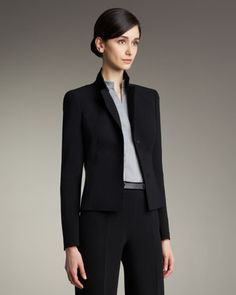 Short Evening Jacket by Akris at Bergdorf Goodman.  Black double-face knit, slit cuffs, box pleats, and darts.