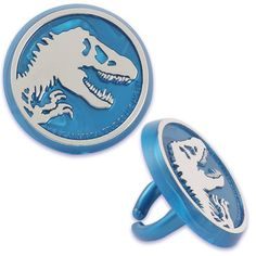 Take your cupcakes up a notch with these Jurassic World Rings! The package includes 12 plastic rings that feature a skeleton of a T-Rex. The rings can then be sent home as party favors. [ cupcakes not included. Jurassic World Cake, Jurassic Park Party, Jurassic World Dinosaurs, Dinosaur Wedding, Dinosaur Party Favors, Dinosaur Birthday Party, Dinosaur Cupcakes, Park Birthday, 6th Birthday Parties