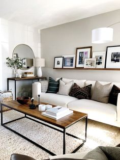 Natural, Neutral Living Room White couch with dark pillows ground the living room with a ton of texture and clean lines. Wood coffee table and console styling. Living Room White, White Rooms, Home Living Room, Apartment Living, Living Room Designs, Living Room Neutral, Cozy Living, Living Area, Living Room Inspiration