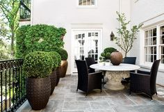 lovely garden patio and I love the acanthus capital table base