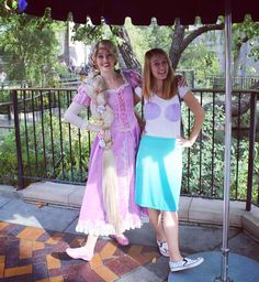 Wish we could turn back time to the good old days  Missing my days roaming Disneyland in my Ariel #disneybound  Time spent with Punzie is always a treat! #tangledtuesday #throwback #disneyland #punzie #arieldisneybound #homemadetshirt #minniemouseshoes #disneylover by magicalprincesslife
