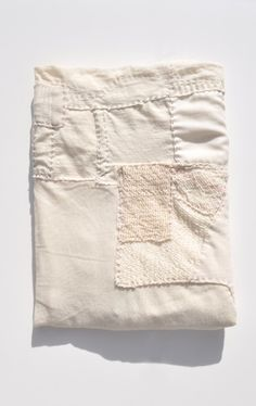 "Handmade extra fine merino wool patchwork blanket from Line Sander Johansen's ""Scrap Work"" collection."