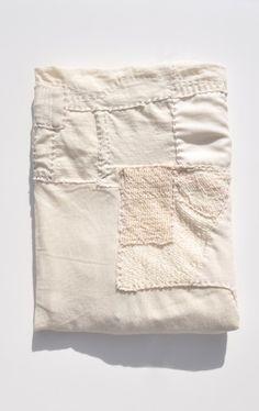 """Handmade extra fine merino wool patchwork blanket from Line Sander Johansen's """"Scrap Work"""" collection."""