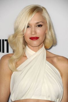 The epitome of Old Hollywood glam, Gwen Stefani's signature shade is her secret to that luminous glow. Get more blonde hair inspo here!