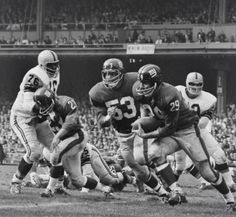 New York Giants' Alex Webster #29 running the ball against Pittsburgh (1962).