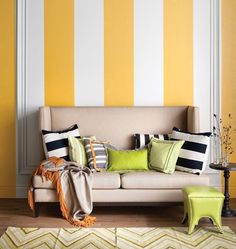 """Ahhh! cute! Yellow-Striped Living Room: For instant impact, paint walls with 16""""-wide vertical stripes in a simple two-toned palette. Take the stripes right over baseboards and mouldings for added drama. Continue the theme with striped accessories — different widths easily mix as long as every pattern has a similar background colour."""