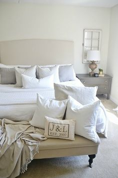 Love the ottoman at the foot of the bed and the nightstand. Love everything in this house actually!