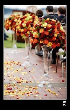 Orange and red roses pew markers outdoor fall wedding