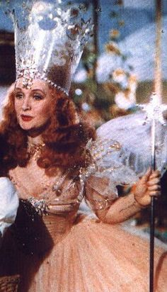 "~To anything less than happy~ Glinda, ""You have no power here. Be gone before someone drops a house on you too!"""