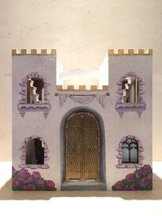 Welcome to my fairytale! What little girl doesnt want to get lost in an enchanting castle? Each castle is hand painted and one of a kind. Perfect size for Disney MagiClip dolls. The inside of the castle is wallpapered and hand painted pieces adorn the walls, such as dresses, furniture, chandeliers, etc. This castle is white with purple accents. It is sparkling and glittery on the outside. This is a wonderful gift for the little girl who loves princesses and fairytales, or as a beautiful…