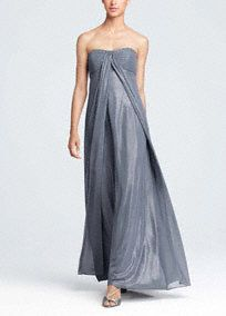 This strapless fog foil dress has a split front with beading at the bust. It softly drapes over the body and creates a flattering silhouette. This unique fabric has a shimmer to it, allowing the wearer to really shine. Fully lined. Back zip. Imported polyester. Dry clean.